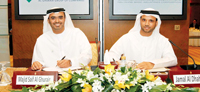 Al Ghurair (left) and Al Dhaheri signing the JV deal