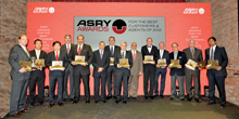 Winners of Asry's awards for the best customers and agents of 2012 pose with their trophies