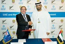 McCully and Dr Al Jaber signing the agreement between the UAE and New Zealand
