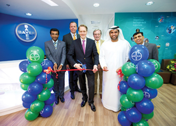 Liedtke (second left), Meyer (third left) and Janahi (in Arab garb) at the ribbon-cutting ceremony