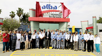 Alba officials gather at the company's newly renovated gate area