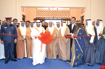 Prince Khalifa cuts a ribbon to open the shows