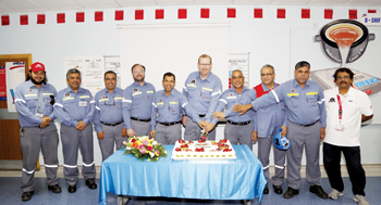 Murray (sixth from left) at the Safety Health and Environment Week held by Reduction Lines 1 to 3