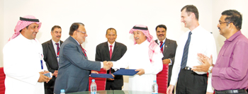 Mustafa and Al Sayed of Hempel exchanging documents at a contract signing ceremony