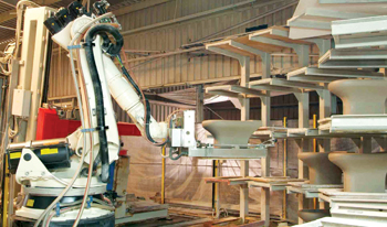 A robot glazing machine at work at an RAK Ceramics production facility