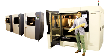 3D printers at the Paradigm 3D plant, a division of D2M Solutions. At right Fortus 900, a 3D printer at Paradigm 3D with the largest build capacity