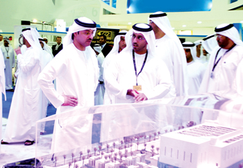 Dignitaries at a stall in Adipec