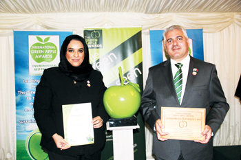 Al Ansari (right) and Al Aradi with certificates of the Green Apple awards in London