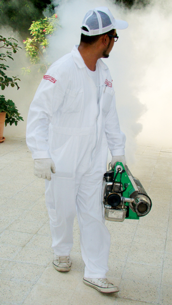 Fog of extermination: A Masa technician goes about his work