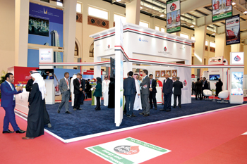 Officials and visitors at the Bapco booth