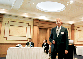 Turki speaking at a Kirby business seminar in Bahrain. Others from left are Vasudev and El Gamil