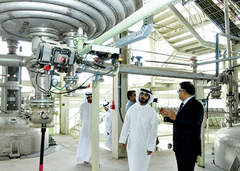 Nair in conversation with Sheikh Khaled at the plant