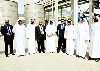Officials and guests at the plant opening