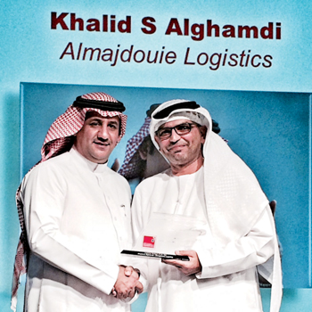 Alghamdi (left) receiving the SCATA honour
