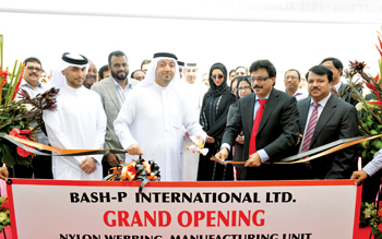 Saud Salim Al Mazrouei, director of SAIF Zone and Hamriyah Free Zone, opening Bash-P International's lifting webbing factory at SAIF Zone