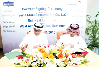 Al Zamil (right) and Albadah signing the agreement
