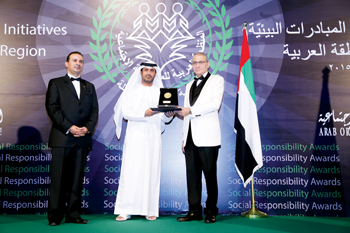 Ali Alabdulla, a senior director at Majid Al Futtaim Properties (left), is presented with the award