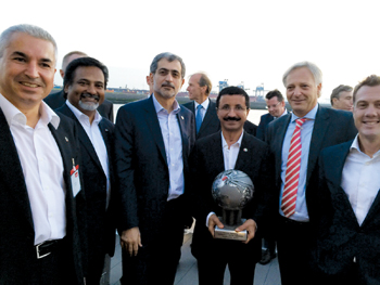 Bin Sulayem (holding a globe) at the opening of RWG