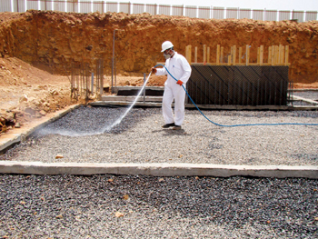 A Masa technician on a spraying assignment at a construction site