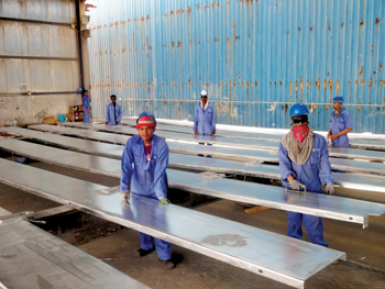 Al Ajab workers readying steel products for galvanising