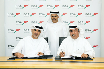 Al Hashimi (right) and Dr Al Zarouni sign the technology transfer agreement watched by Kalban