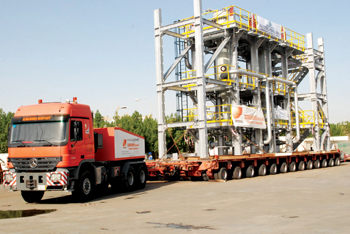 An Almajdouie truck transporting heavy and outsized cargo