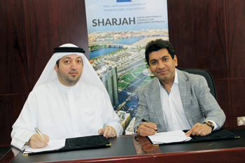 Al Mazrouei and Moorjani signing the lease agreement