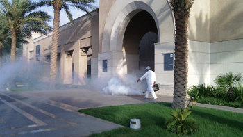 A fog of protection spreads as a Masa pest control technician goes about his work