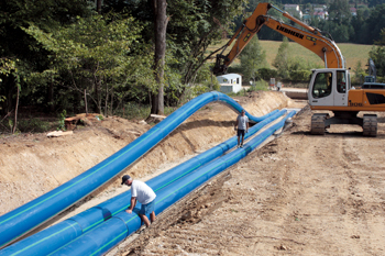 Trench installation of the flexible Agru Sureline pipe with protective layer