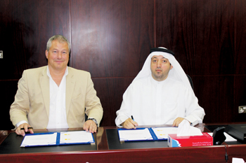 Al Mazrouie (right) and Buchholz signing the lease agreement