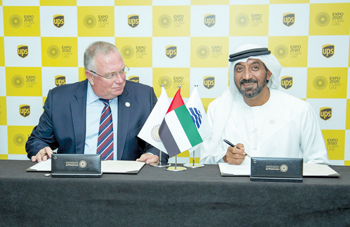 Sheikh Ahmed (right) and Condamine sign the agreement
