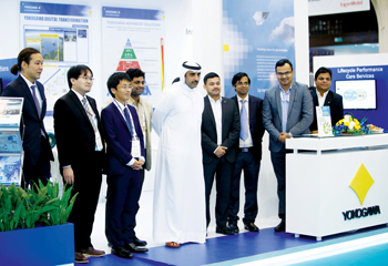 Yokogawa staff with Bahrain's Oil and Gas Minister Shaikh Mohammed bin Khalifa Al Khalifa