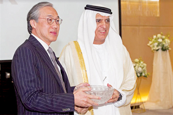 Eric Ip and Sheikh Saud at the ceremony