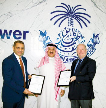 From left to right: Jameel Al Sharaf, Group corporate services manager; Kanoo; and Robert Moss, exec