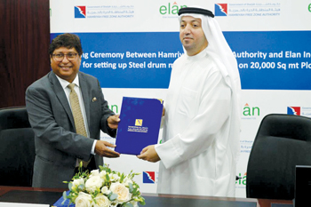 Jain (left) and Saud Salim Al Mazrouei, director, Hamriyah Free Zone, at the ceremony