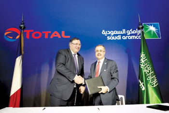 Total's chairman and CEO Patrick Pouyanné  (left) and Aramco president and CEO Amin H Nasser