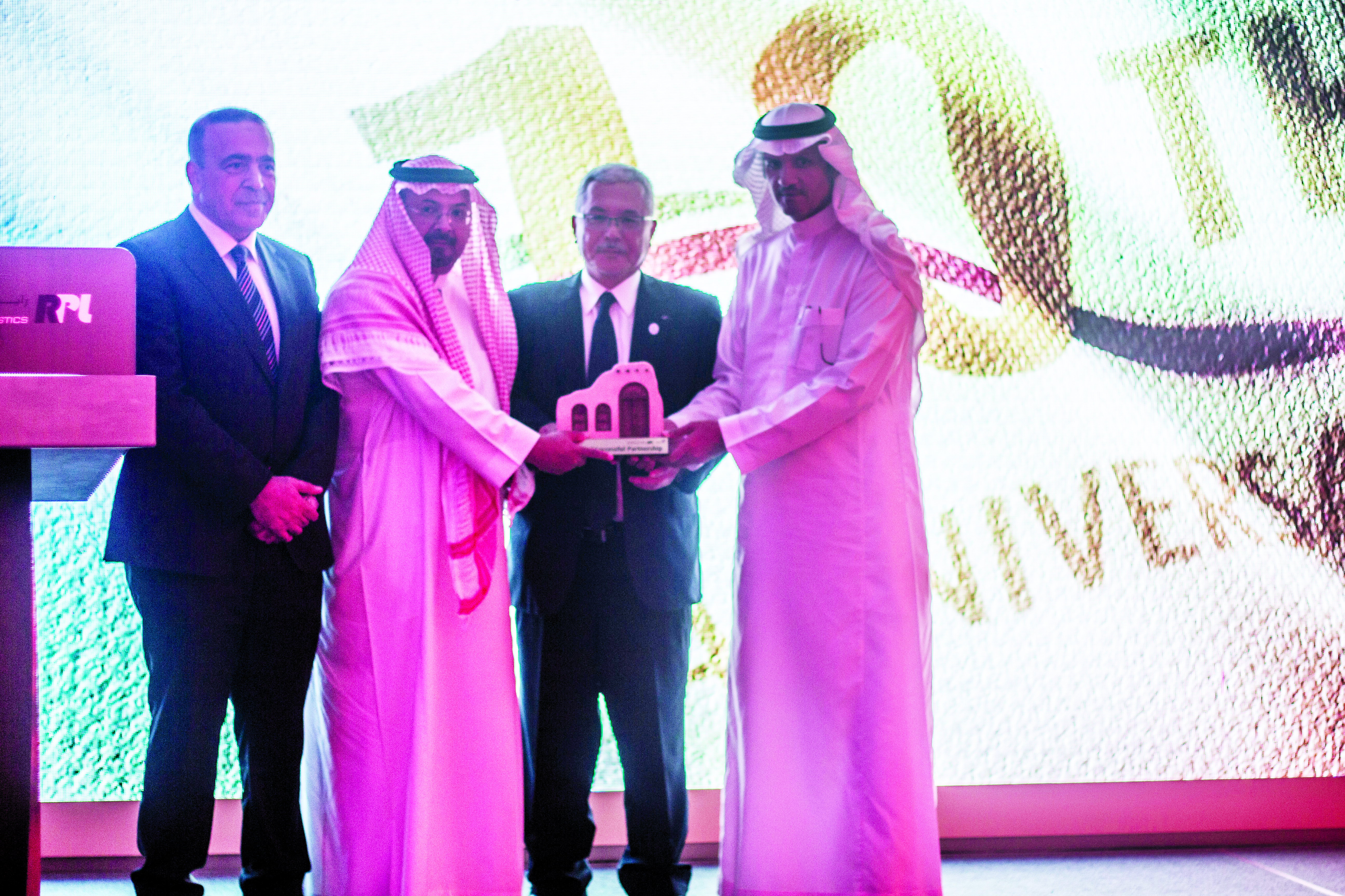 From right to left: Almajdouie; Ono; Saif and Al Biqawi exchanging tokens of appreciation at the cel