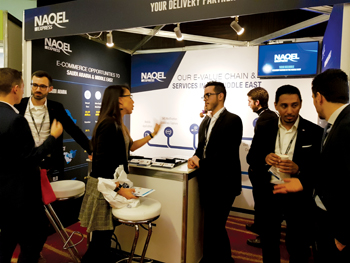 NAQEL staff briefing customers during a logistics conference in London, UK