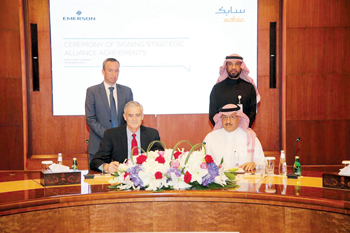 Sabic signing the MoU with Emerson