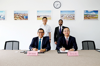 Chaturvedi (front left) and Changjun (front right) sign the agreement in the presence of Liu (back l