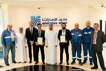 Al Remeithi  with Emirates Steel employees and patent certificates