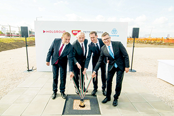 Officials laying the foundation stone of the plant