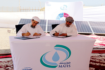 Officials signing the agreement to set up PV solar plant