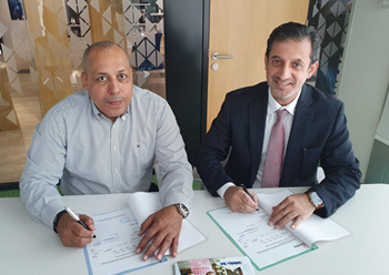 Salah and Yousef (right) signing the distribution agreement
