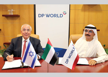 Fogel (left) and Bin Sulayem signing the MoUs